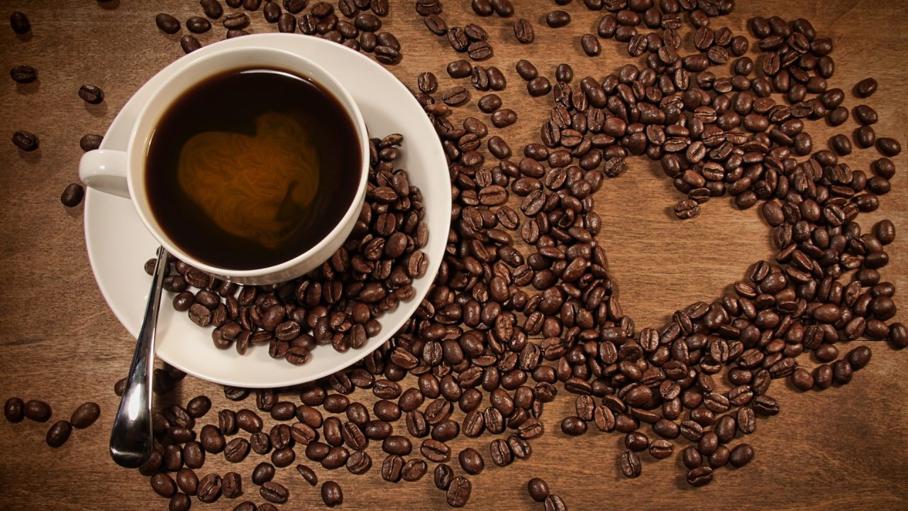 A-cup-of-coffee-coffee-beans-placed-heart-shaped-pattern_1920x1080