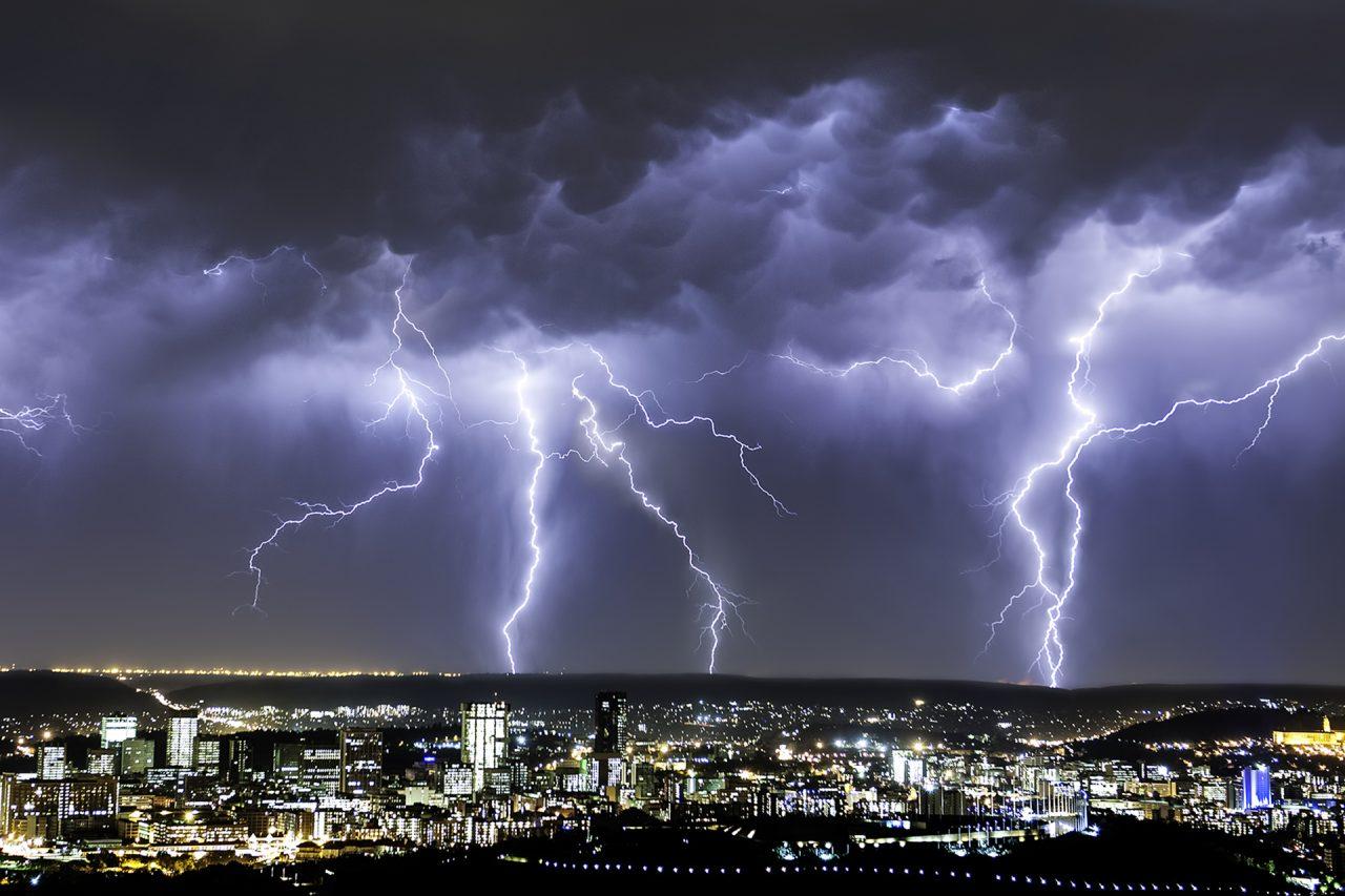 Massive Lightning Strikes From an Intense Summer Thunderstorm dwarfs the city of Pretoria, Gauteng Province, South Africa
