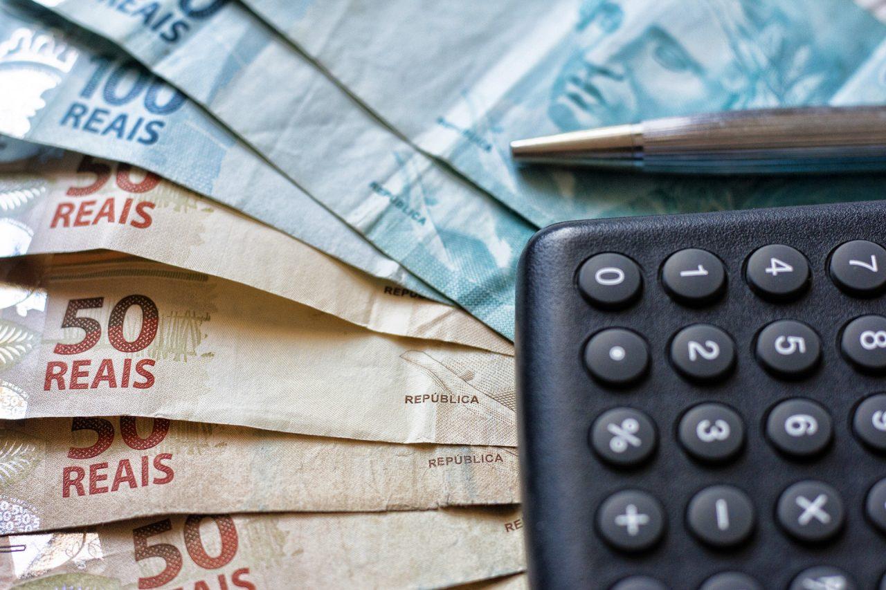 Finance Concept - Calculator, Brazilian Money and Pen