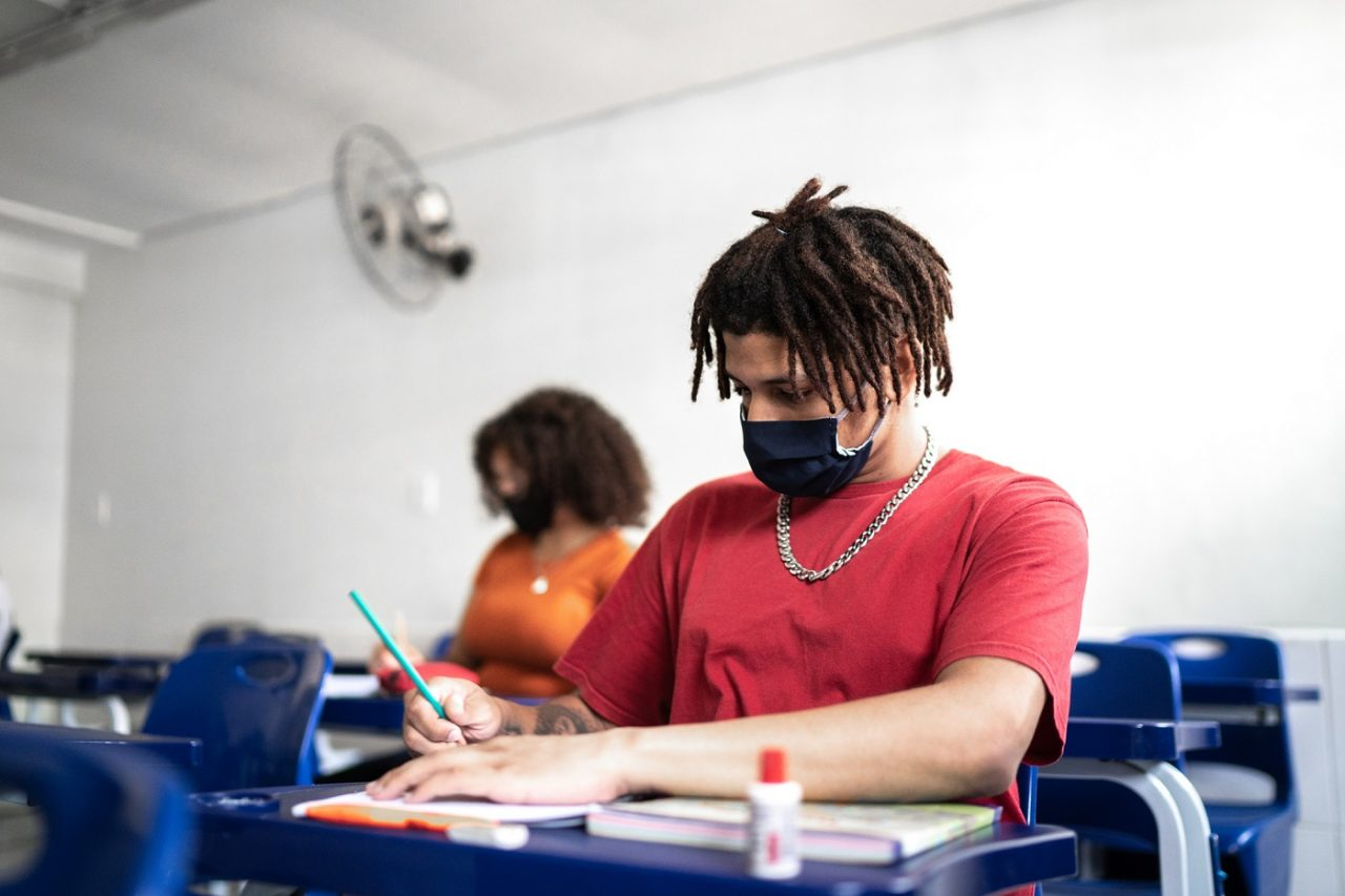 University / high school student wearing face mask while studying in the classroom